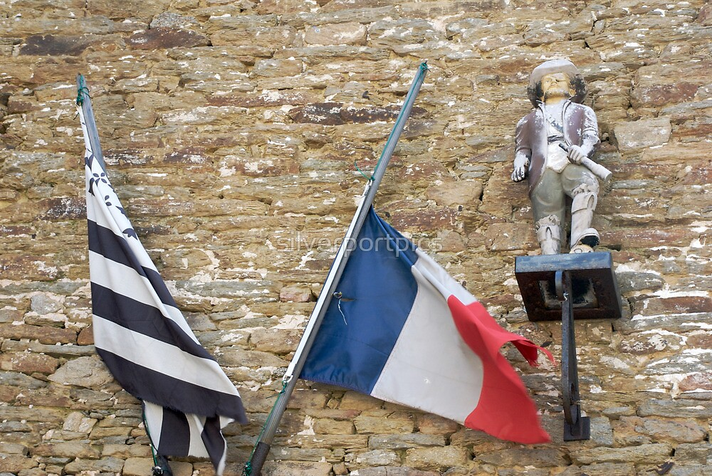 Seafaring figure with Breton and French flags, Brittany, France by silverportpics