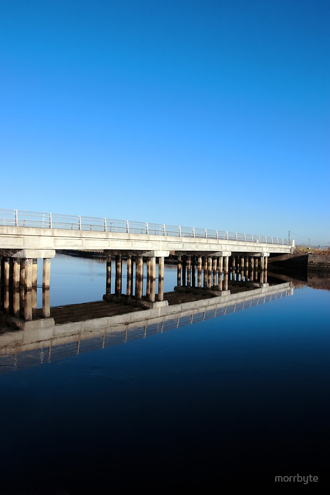 cashen road bridge over cold river reflected by morrbyte