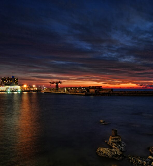 a flaming sunset at Tel Aviv port by Ronsho