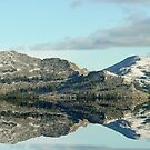 Reflection of mountains by Penny Fawver