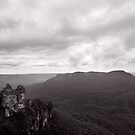 Three Sisters looking toward Mt Gibraltar and Mt Solitary - NSW - Australia by Norman Repacholi