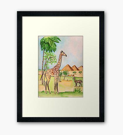 A Giraffe by the Pyramids Framed Print