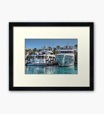 Yachts docked at the Atlantis Marina in Paradise Island, The Bahamas Framed Print
