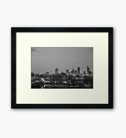 City at dusk Framed Print