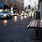 empty bench and busy road by Victor Bezrukov