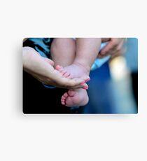 little feet of children Canvas Print