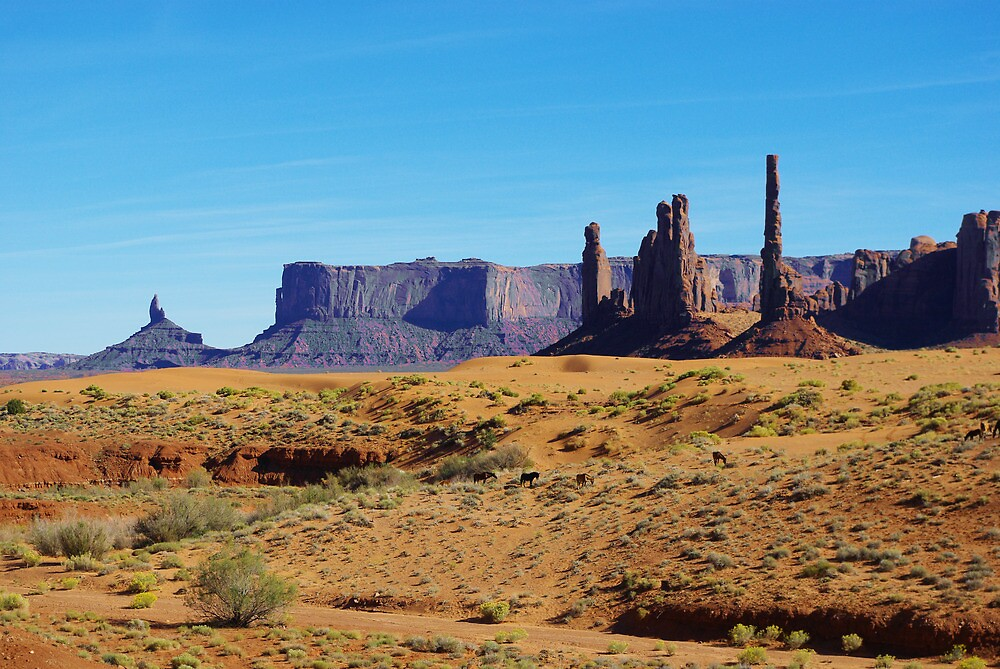 Horses, sand and rock towers, Monument Valley by Claudio Del Luongo
