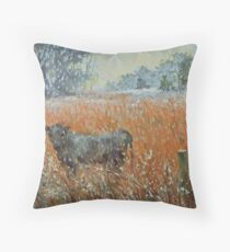Cow in a snow blizzard Throw Pillow