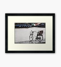 Hoi An bicycle in rain Framed Print