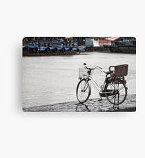 Hoi An bicycle in rain Canvas Print