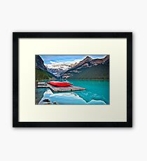 Red Canoes on a Wooden Dock Framed Print