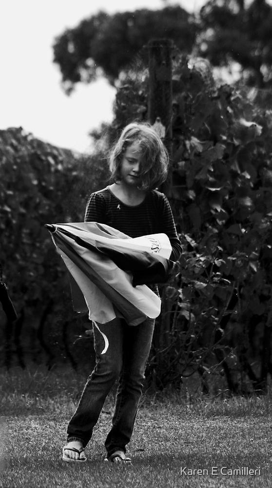 Girl with umbrella by Karen E Camilleri