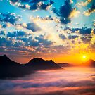 Sea of clouds on sunrise by naphotos