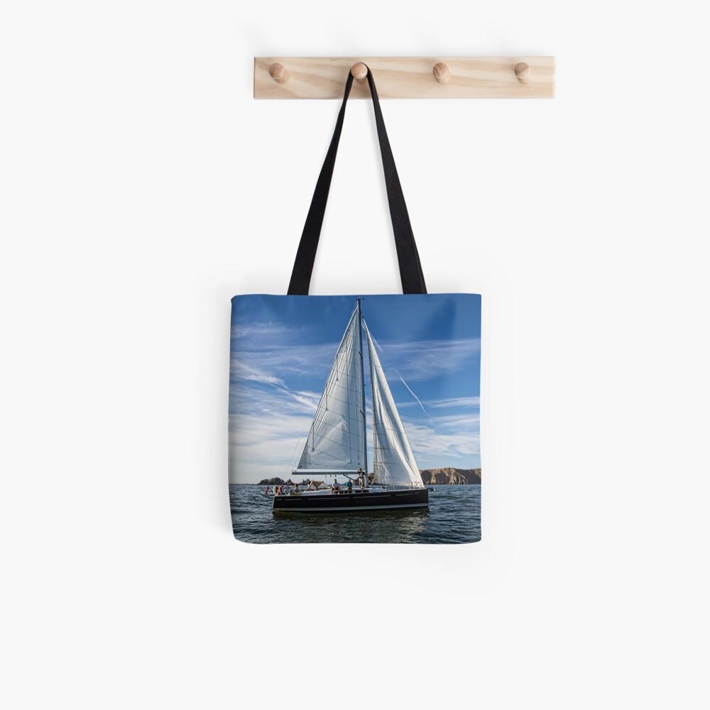 A sail boat off Alderney  Tote Bag