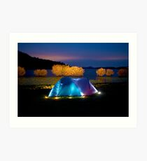 Illuminated tent on dam Art Print
