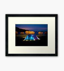 Illuminated tent on dam Framed Print