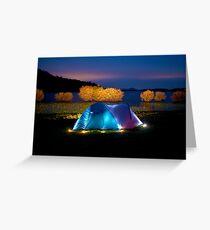 Illuminated tent on dam Greeting Card