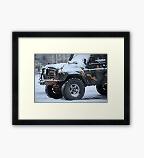 SUV in snow Framed Print