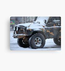 SUV in snow Metal Print