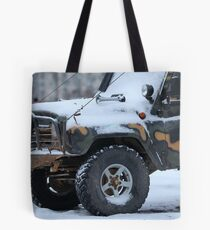 SUV in snow Tote Bag