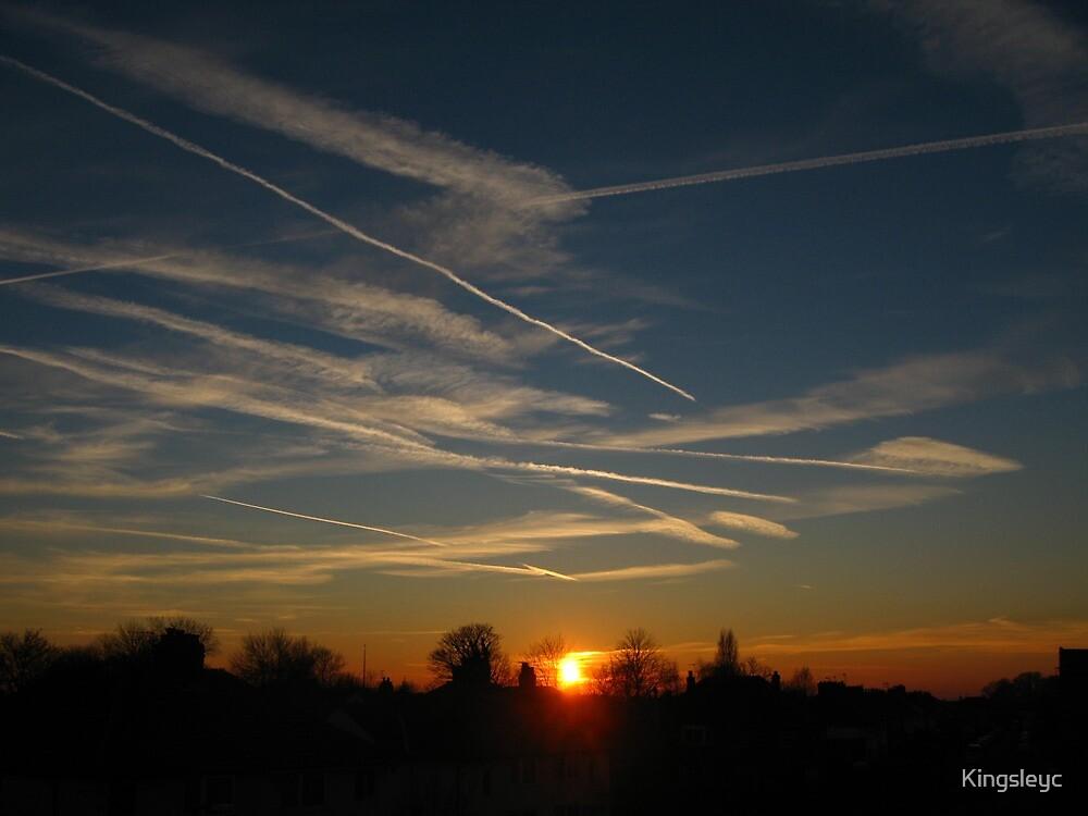 sunrise vapour trails by Kingsleyc