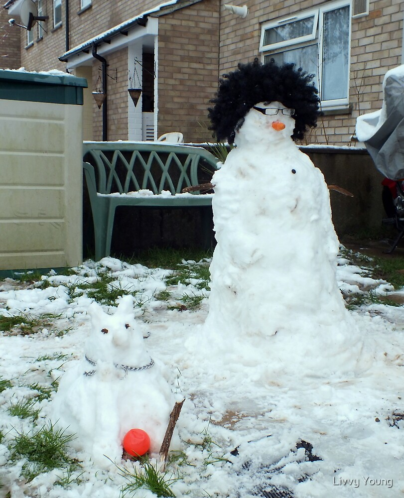 Curly the snowman and his snow dog Fido by Livvy Young
