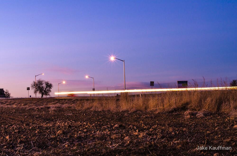 Driving Past at Sunset by Jake Kauffman