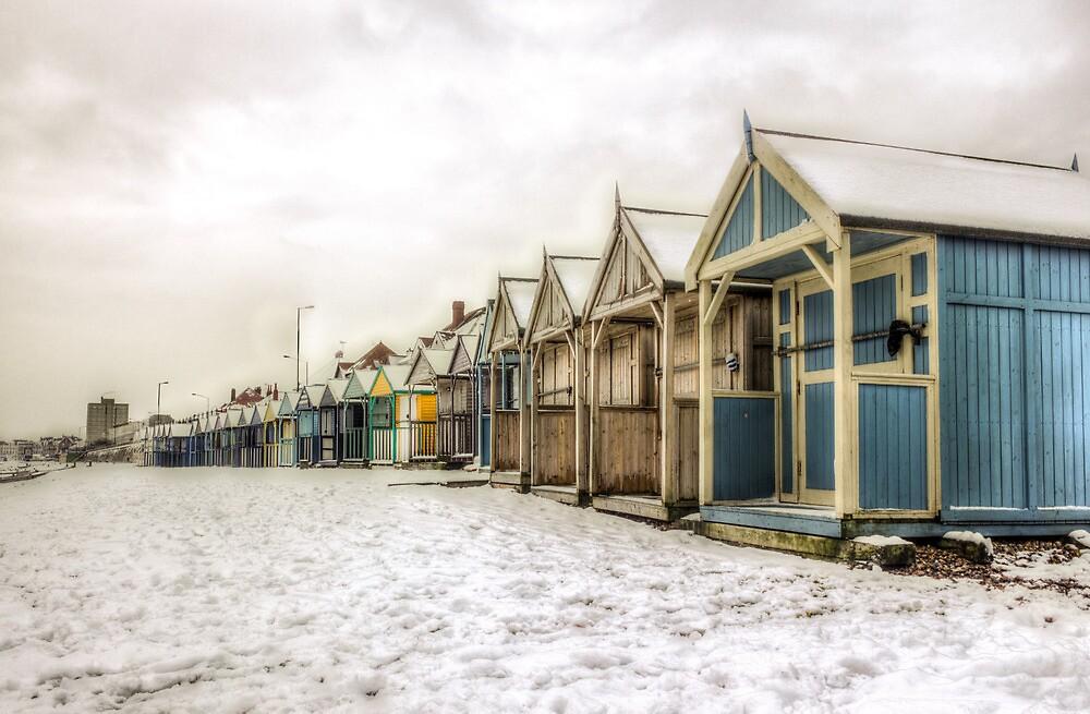 Snowy Beach Huts by Ian Hufton