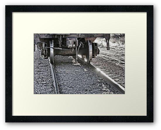 Railroad Train Car Wheels Hitting the Tracks by Bo Insogna