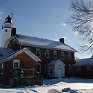FOrt Gratiot Light house in winter by cherylc1