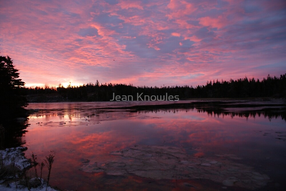 Reflected sunrise on the shore by Jean Knowles