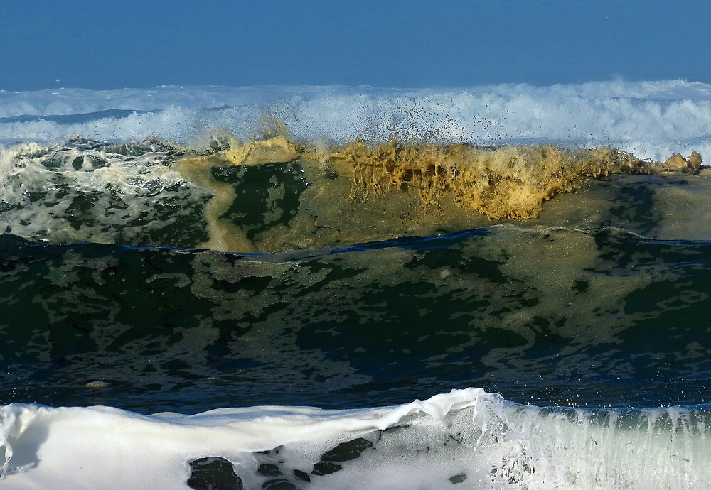 Yellow foam in surf by Alex Call