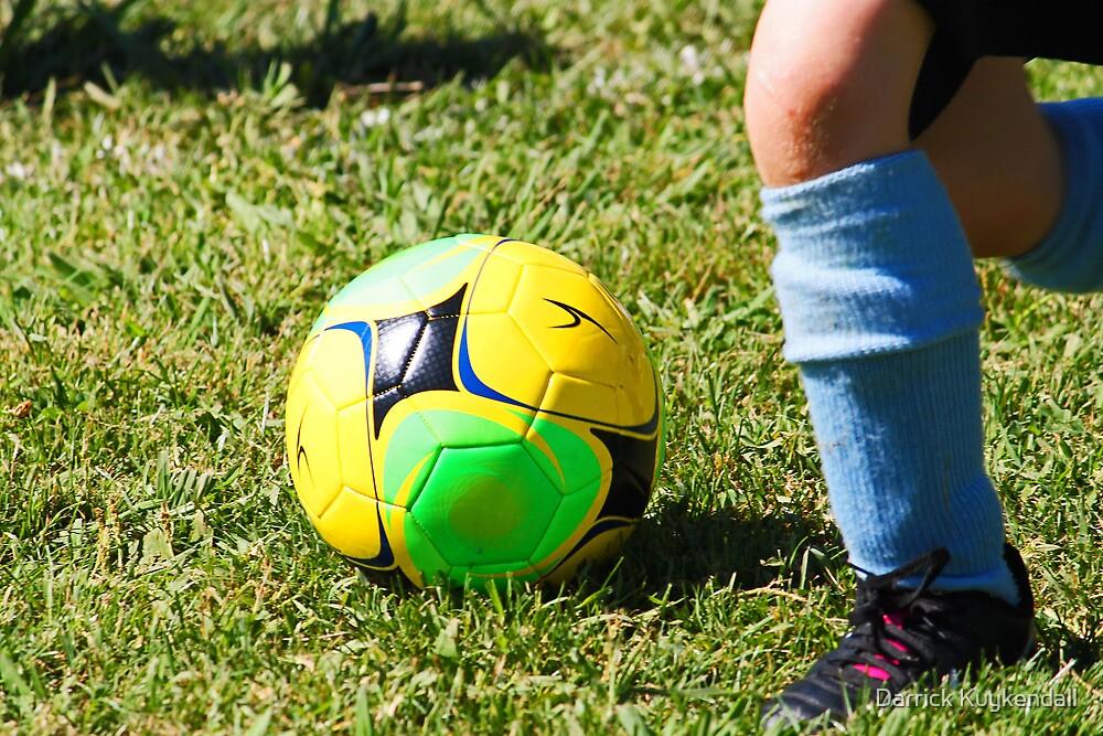 Kicking Soccer Ball by Darrick Kuykendall