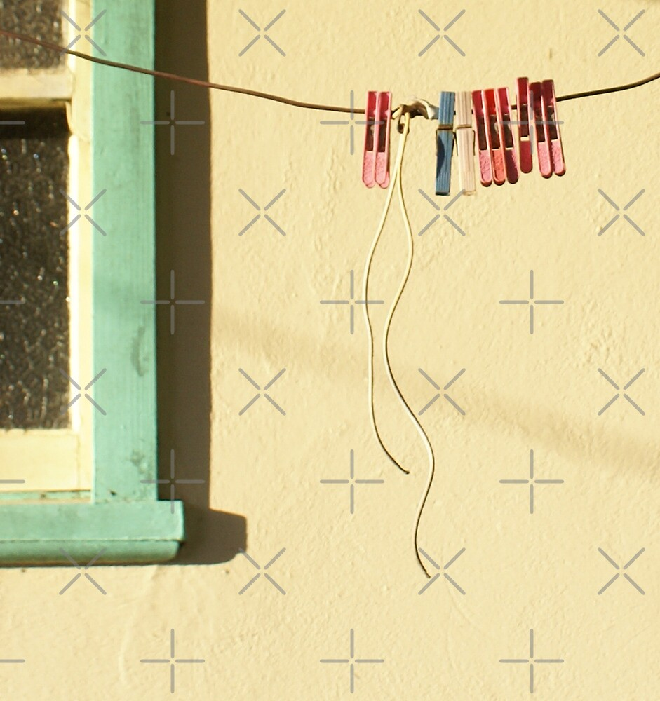 pegs on an old fashioned clothes line by kathybellingham