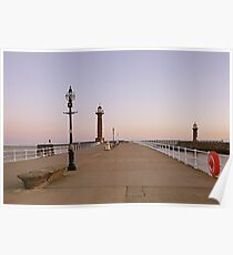 Sunrise over twin lighthouses Whitby. Poster