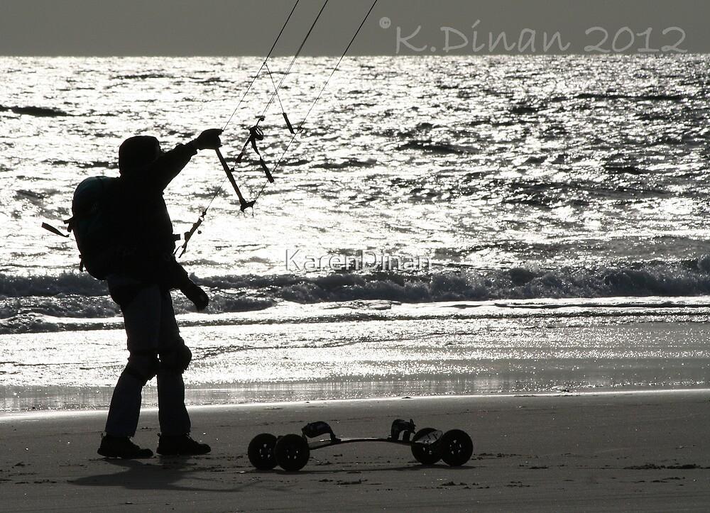 Skateboarding with kite on the beach. by KarenDinan