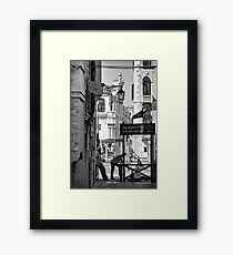 Gondoliers in Venice Framed Print
