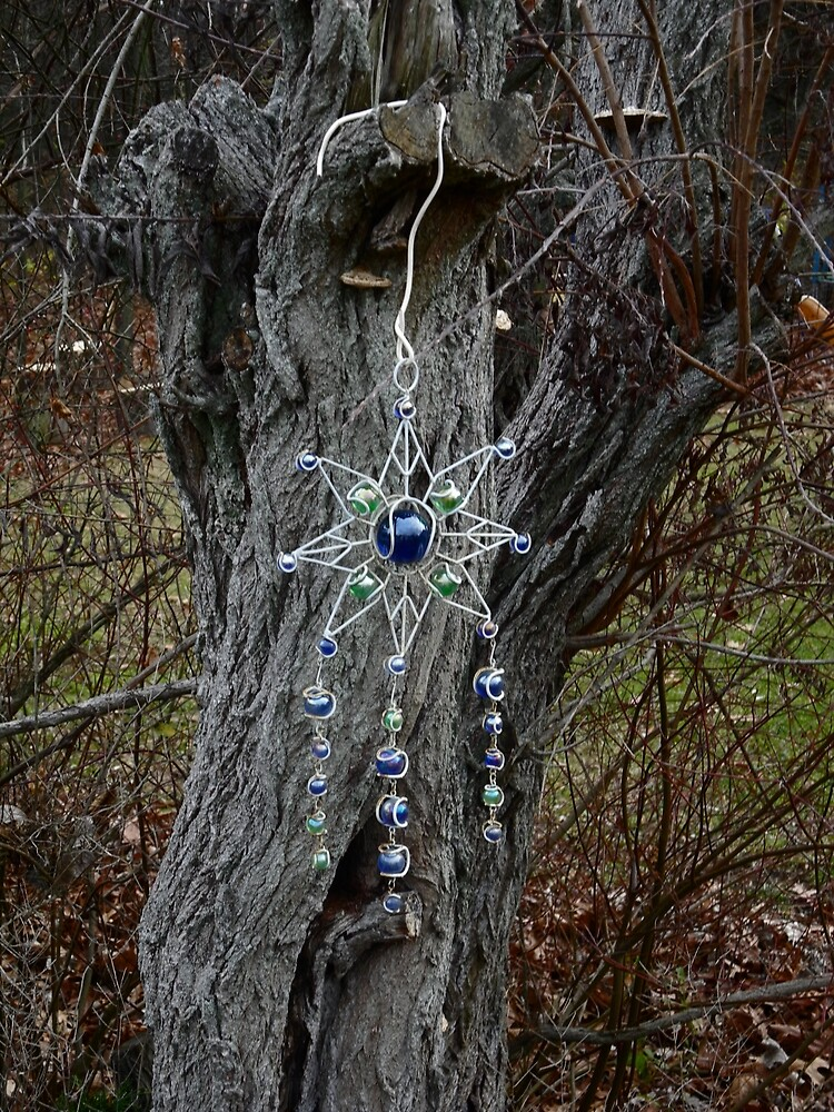 Ornament on a tree by TCbyT