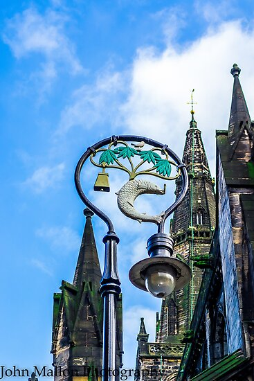 lamppost with symbols of Glasgows coat of arms. by saabbhoy