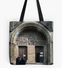 Tourists examining facade Conques Abbey Church St Foy 1040-1130 19840228 0037 Tote Bag