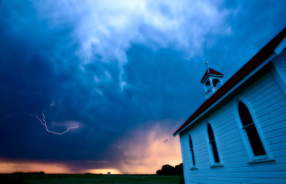 Storm Clouds over Saskatchewan country church by pictureguy
