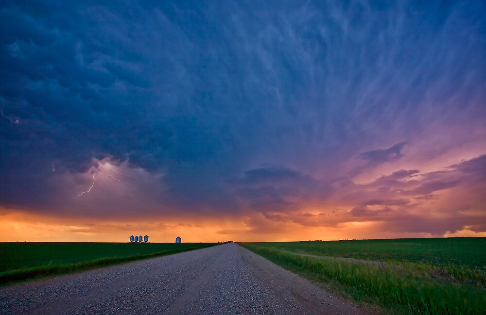 Storm Clouds over Saskatchewan country road by pictureguy