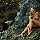 Bikini model posing in front of rocks in Palos Verdes, CA II by Anton Oparin