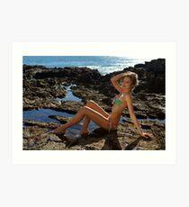 Bikini model posing on lava field in Palos Verdes, CA Art Print