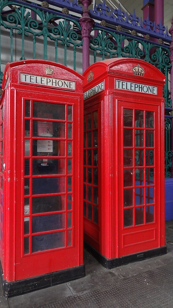 A pair of telephone boxes by Karentreefern