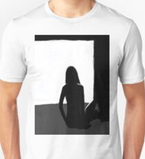 Woman in darkened room T-Shirt
