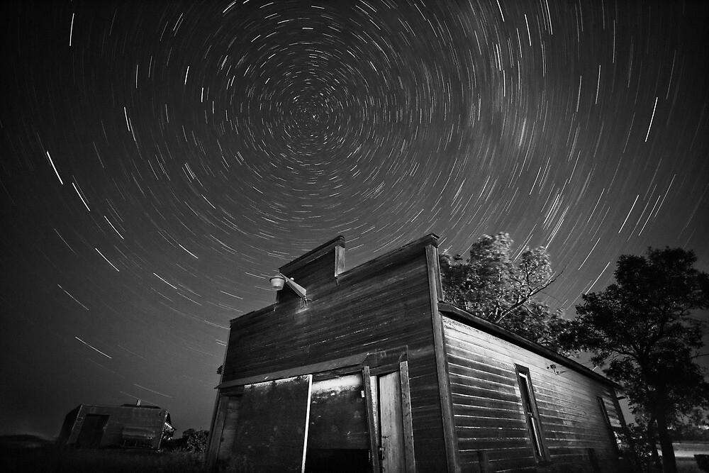 Star tracks over old abandoned garage in Saskatchewan by pictureguy