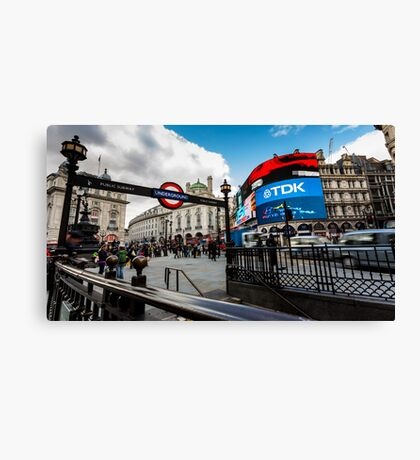 Piccadilly Circus during the day with tourist near the tube Canvas Print