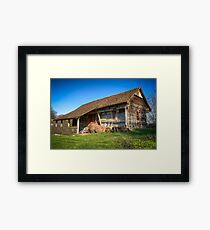 Old and abandoned wooden house Framed Print