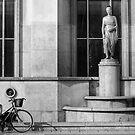 A cyclist near the Eiffel Tower phones a friend, Paris by Elana Bailey